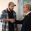 Salvation Army Phillip Aho hands keys to Seth Hurtt for his family's new Habitat home on Wednesday.<br /> Globe | Roger Nomer