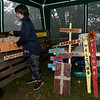 Nicholas Ottendorf, 12, helps organize crafts made by Jennie Craven at their booth at the North Heights Neighborhood's Porch Fest on Saturday on North Byers Avenue.<br /> Globe | Laurie Sisk