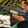 Edna Lopez, machine operator at Flex-O-Lators, works with Flex Mats on Monday at the plant in Carthage.<br /> Globe | Roger Nomer