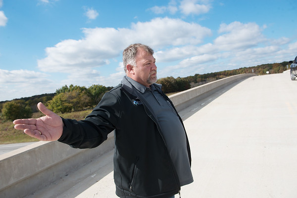 Eddie Rodgers, assistant director of the Quapaw Services Authority, talks about road improvements near Quapaw on Friday.<br /> Globe | Roger Nomer