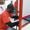 Gene Striplin reads his ballot during early voting for the 2018 midterm election at the Homer Cole Community Center on Tuesday in Pittsburg. Election officials reported heavy turnout for early voting at the site.<br /> Gobe | Laurie SIsk
