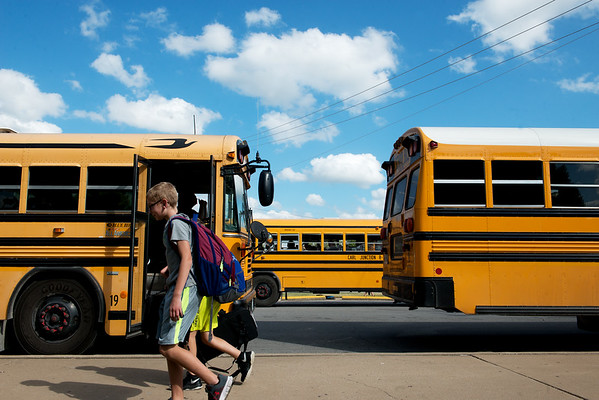 Carl Junction students load busses on Wednesday afternoon.<br /> Globe | Roger Nomer