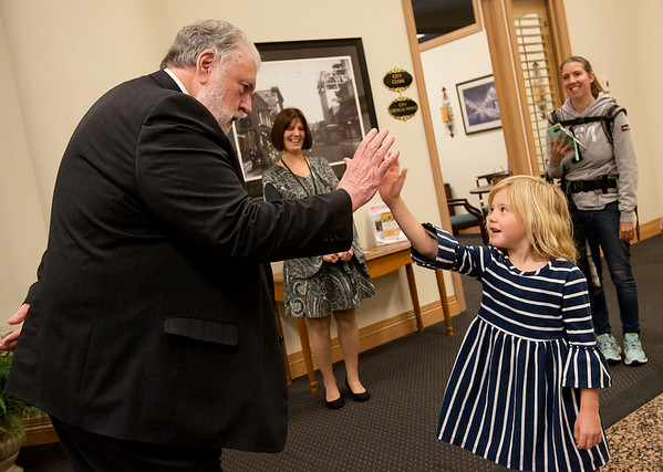 Joplin Mayor Gary Shaw greets Taylor Duncan, 5, with a high five on her arrival at City Hall on Thursday.<br /> Globe | Roger Nomer