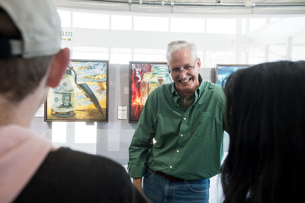 Michael Steddum talks with Missouri Southern students about his paintings during Wednesday's Nanette Philibert Business of Art Symposium at Missouri Southern State University.<br /> Globe | Roger Nomer
