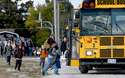 Granby students board buses in preparation for another three-day weekend. The district is reviewing the success of their four-day school week after two years of implementation. Globe | Laurie Sisk
