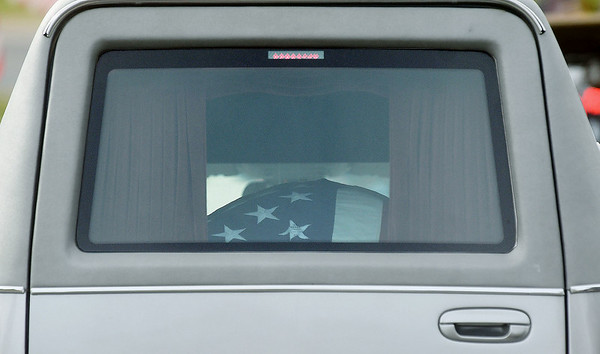 A hearse containing the casket and remains of WWII soldier Leslie Shankles, of Arcadia, arrives at the Fort Scott National Cemetery in preparation for burial with full military honors on Wednesday afternoon - 74 years after Shankles death.<br /> Globe | Laurie Sisk
