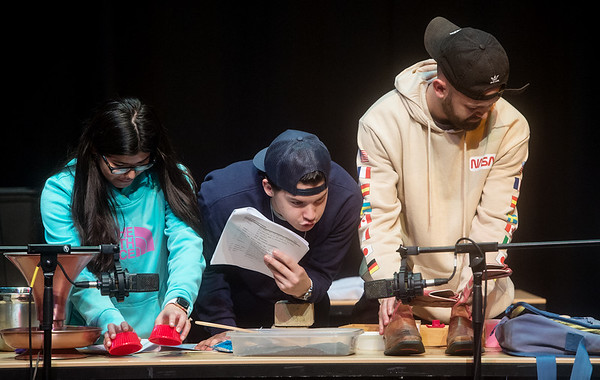 (from left) Vanessa Tapia, Bailey Noland and Braiden Turner, all seniors at Pittsburg State University, provide Foley effects for a play on Tuesday at the Bicknell Family Center for the Arts.<br /> Globe   Roger Nomer