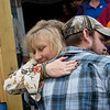 Tammy McBee, Joplin Area Habitat for Humanity board member, gives a hug to Seth Hurtt after the dedication of his family's home on Wednesday.<br /> Globe | Roger Nomer