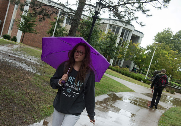 Haley Crane, Missouri Southern a freshman from Overland Park, uses an umbrella on campus on Oct 10.<br /> Globe | Roger Nomer