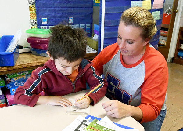 Granby kindergarten teacher Susan Wilson assists Christian Aguilera, 5, during class on Friday at Granby Elementary. The district is reviewing the success of their four-day school week after two years of implementation.<br /> Globe | Laurie Sisk