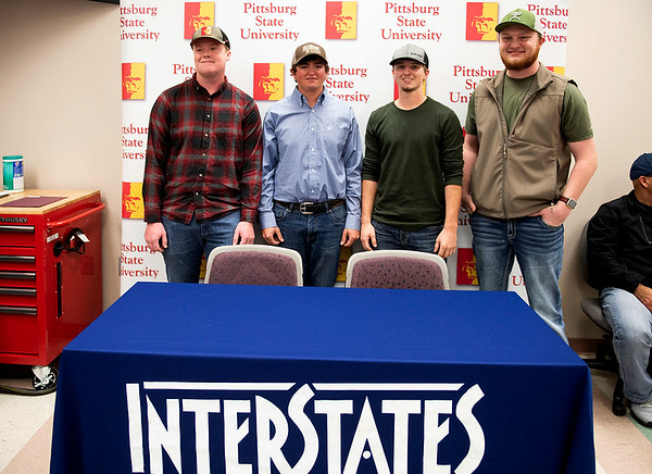 (from left) Jace Burdick of Rose Hill, Kan., Cody Mein of Pittsburg, Brandon Walker of Girard and Stephen Gideon of Weir, signed with electrical construction company Interstates at Pittsburg State University on Monday. The Electrical Technology program students previously interned with the company, and now will enter the company's apprenticeship program.<br /> Photo Courtesy Pittsburg State University