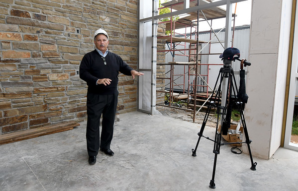 Architect Dan Rowe leads a tour inside the lobby of the new Jasper County Juvenile Justice Center with court and county officilas and members of the media on Wednesday at the center near Sixth and Pearl streets.<br /> Globe | Laurie Sisk