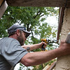 David Perry installs an exaust fan cover in a house on Moffet Street in Joplin on Tuesday.<br /> Globe | Roger Nomer