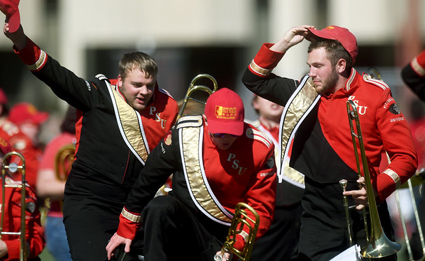Members of the Pittsburg State Pride of the Plains Marching Band rev up the crowd before the start of PSU's Homecoming game against Central Missouri on Saturday at Carnie Smith Stadium.<br /> Globe | Laurie SIsk