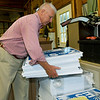 Retired cardiologist Paul Callicoat organizes yard signs in his garage on Wednesday at his Seneca home. Callicoat has been active in endorsing Proposition 2 for the legalization of medical marijuana.<br /> Globe | Laurie Sisk