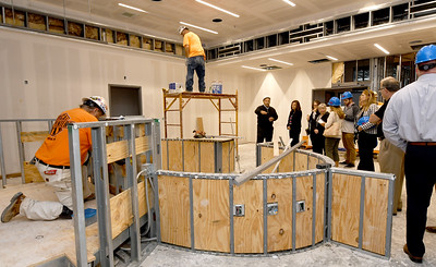 Work continues on the court room inside the new Jasper County Juvenile Justice Center as court and county officilas and members of the media tour the building on Wednesday at the center near Sixth and Pearl streets. Globe | Laurie Sisk