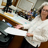 Linda Goodman talks about using the voting machine during an interview on Monday at the Newton County Courthouse.<br /> Globe | Roger Nomer