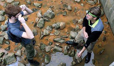 From the left: Pittsburg State University biology majors Ryan McGinty and Jake Wright prepare to enter a storm drain where gray bats roost on Wednesday in Pittsburg. PSU researchers are monitoring incidents of white nose syndrome, which can be fatal to bat colonies. Globe | Laurie Sisk