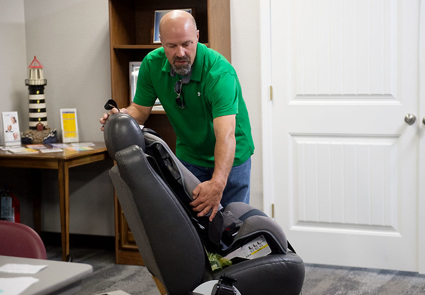 Mark Box, Safe Kids Coordinator with The Alliance of Southwest Missouri, talks about car seat safety during a class on Wednesday. Parents and a Mercy NICU nurse attended the safety class, which is held monthly by the Alliance.