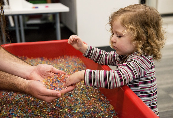 Petra Welch, 2, Joplin, plays with a water bead table during the Creative Learning Alliance's community forum on a children's museum on Tuesday at the Joplin Public Library.<br /> Globe | Roger Nomer
