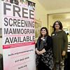 From the left: Breast Cancer Foundation of the Ozarks Program Director Lori Gold and Outreach Director Kristi Seibert stand beside a sign advertising free mamograms to those who are either uninsured or underinsured last month at Joplin Mercy Hospital.<br /> Globe | Laurie Sisk