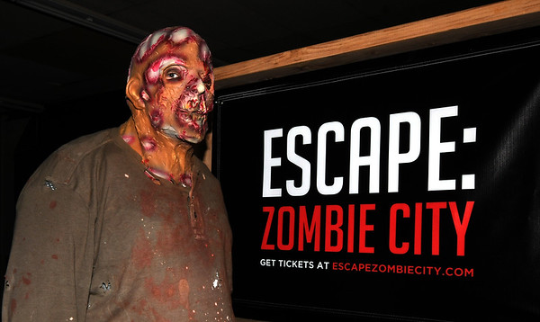 Zombie actor Josh Kayser stands near the start of the Escape: Zombie City experience on Thursday in downtown Joplin.<br /> Globe | Laurie Sisk