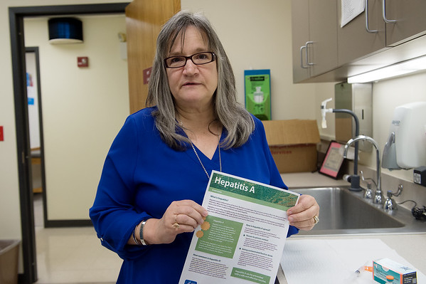 Cynthia Burnham, medical division coordinator for the Joplin Health Department, talks about preventing Hepatitis A on Monday at the department.<br /> Globe | Roger Nomer