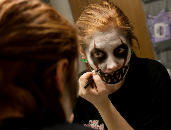Meagan Pippin works on her Halloween make up on Thursday afternoon at her Webb City home.<br /> Globe | Roger Nomer