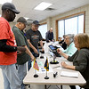 Voters check in to cast their ballots during early voting for the 2018 midterm election at the Homer Cole Community Center on Tuesday in Pittsburg. Election officials reported heavy turnout for early voting at the site.<br /> Gobe | Laurie SIsk
