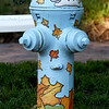 A brightly-themed hydrant near 14th and Grand adds to the festive atmosphere at the Maple Leaf Parade on Saturday in Carthage.<br /> Globe | Laurie Sisk