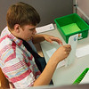 Michael Millman Jr., known as Little Michael, practices folding letters and putting them in envelopes at Heartspring in Wichita, Kan., on June 8. Heartspring helps those with special needs learn job and life skills so they can become employable and support themselves.<br /> Globe | Roger Nomer
