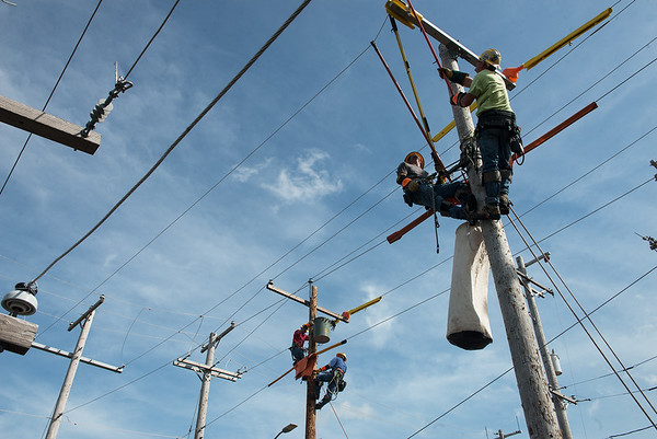 Groups of linemen train in preparation for the Internation Lineman's Rodeo at Liberty Utilities Empire District on Monday.<br /> Globe | Roger Nomer