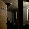 An open door to a police sergeant's office entices participants inside the Escape: Zombie City experience on Thursday in downtown Joplin.<br /> Globe | Laurie Sisk