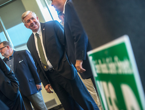Gov. Mike Parson talks with Sen. Ron Richard following their remarks on Prop D at Missouri Southern on Wednesday.<br /> Globe | Roger Nomer