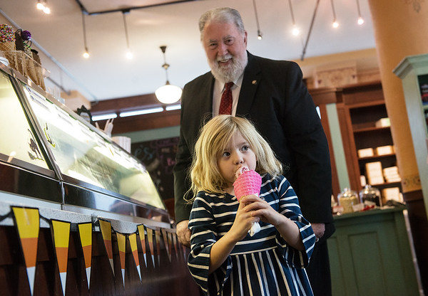 Taylor Duncan, 5, gets a strawberry ice cream cone with Joplin Mayor Gary Shaw on Thursday at Sweet Caroline's.<br /> Globe   Roger Nomer