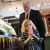 Taylor Duncan, 5, gets a strawberry ice cream cone with Joplin Mayor Gary Shaw on Thursday at Sweet Caroline's.<br /> Globe | Roger Nomer