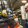 Bruce Sheat, maintenance tech at Flex-O-Lators, looks over a machine on Monday at the plant in Carthage.<br /> Globe | Roger Nomer