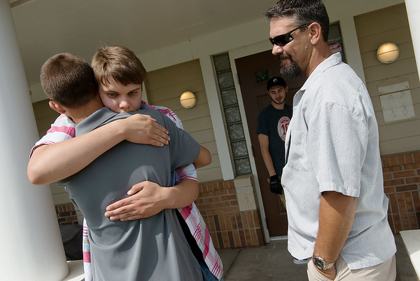 Michael Millman Jr., also known as Little Michael, says goodbye to his brother Lucas, 14, and father Michael Sr. following their visit to Heartspring on June 8 in Wichita, Kan.<br /> Globe | Roger Nomer