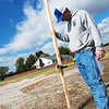 Mitch Albright, assistant director of agriculture for the Quapaw Nation, takes measurements for elder housing on Friday in Quapaw.<br /> Globe | Roger Nomer