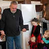 Allen Harris, grandfather of Seth Hurtt, offers a prayer as (from left) Salvation Army Major Phillip Aho, Atlas, 1, Reilly, 6, Jacyln and Adilyn, 3, Hurtt listen during Wednesday's dedication of the Hurtt's Habitat house.<br /> Globe | Roger Nomer