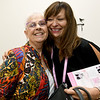 Cancer survivor Stella McGowen gets a hug from Wacoal consultant Nancy Balkenbush inaide Sisters Boutique at Joplin Mercy Hospital.<br /> Globe | Laurie Sisk