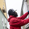 Marcus Bailey, with Economic Security Corporation, seals a window at a Joplin residence on Wednesday.<br /> Globe | Roger Nomer