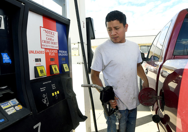 Freddy Morales fills his truck with gasoline on Tuesday at Doc's Stop on 32nd Street. <br /> Globe | Laurie Sisk