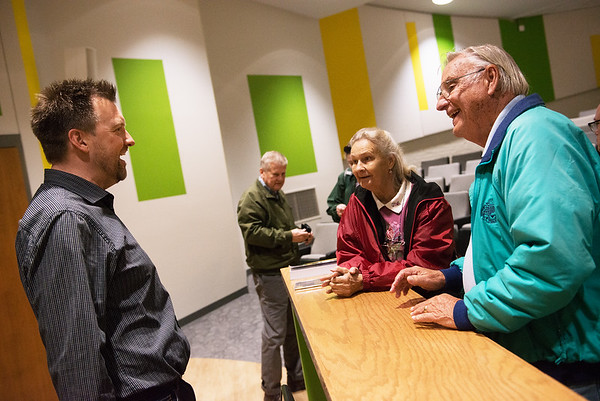 Carl Magnus Palm talks with siblings Dorothy Bay and John Bay following his lecture on Swedish pop music at Missouri Southern on Thursday.<br /> Globe | Roger Nomer