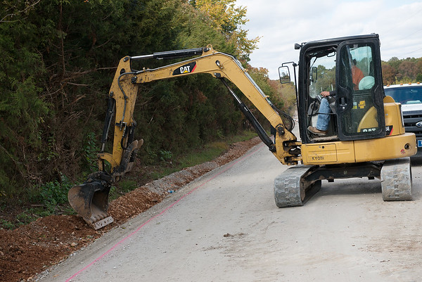 Work continues by the Quapaw Services Authority on roads near Quapaw on Friday.<br /> Globe | Roger Nomer
