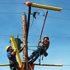 Eric Clark, left, and Aaron Bittle train in preparation for the Internation Lineman's Rodeo at Liberty Utilities Empire District on Monday.<br /> Globe | Roger Nomer