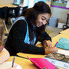 Samara Dodson, eighth grader at East Middle School, works on a comm arts assignment on Thursday.<br /> Globe | Roger Nomer