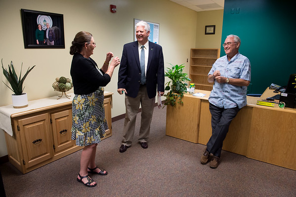 Missouri Southern State University President Alan Marble talks with Tracy and Bill Gipson on Tuesday during an open house for the Gipson Center for Health Care Leadership.<br /> Globe | Roger Nomer