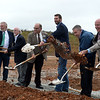 Officials shovel dirt during Tuesday's groundbreaking of the Bella Vista Bypass near Gravette.<br /> Globe | Roger Nomer