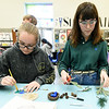 From the left: Carthage High School juniors Enessa Smith and Molly Long work on an ornament recognizing the state bird of Missouri - the blue bird - on Tuesday at CHS. The 24 ornaments designed by CHS students will decorate a Christmas tree representing Missouri in the nation's capitol.<br /> Globe | Laurie Sisk